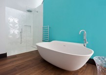 Classy contemporary bathroom with a turquoise accent wall