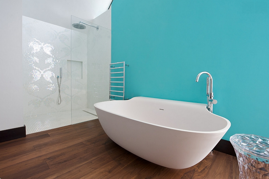 Classy contemporary bathroom with a turquoise accent wall [Design: Yorkshire Design Associates]