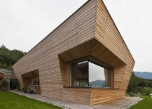 Clean, straight lines of the facade are softened by the elgant use of wood