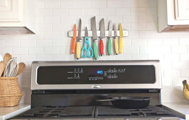 Colorful knives on a knife magnet