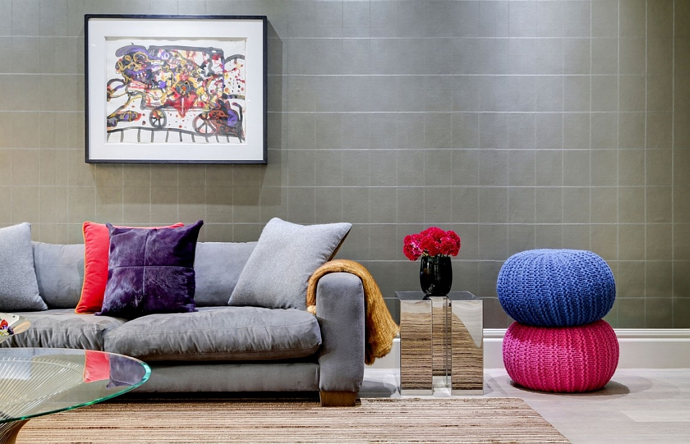 Colorful throw pillows and plush ottomans add textural and visual beauty to the bachelor pad