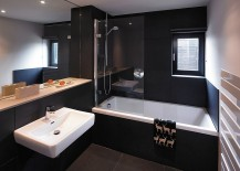Contemporary bathroom balances dark and light elements elegantly