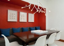 Contemporary dining room uses red as an accent hue