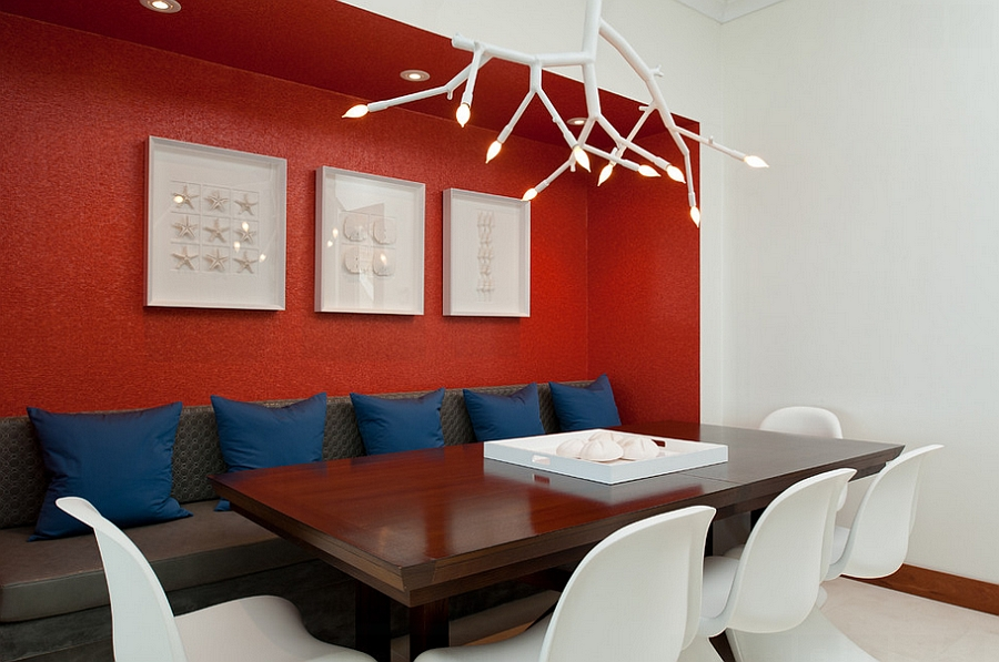 Contemporary dining room uses red as an accent hue [Design: LKID]
