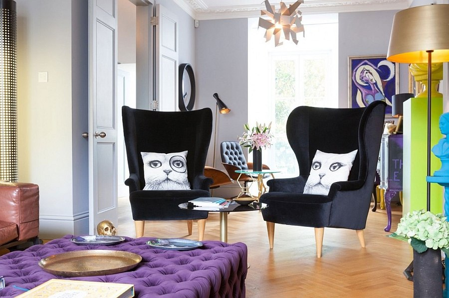Contemporary wingback chairs and imaginative throw pillows in the living room