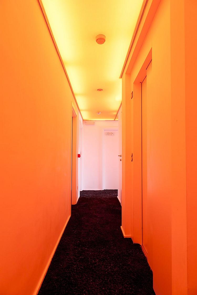 Corridor of the Pantone Hotel draped in orange