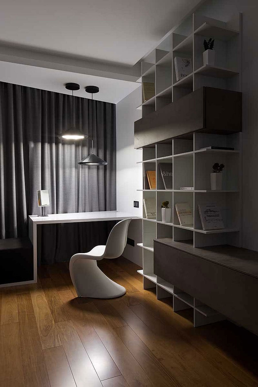 Creative display and storage space alongw ith focussed lighting for the home office