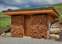 Creative freestanding woodshed can become a unique addition to your backyard