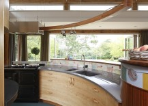 Curved kitchen island and workstation with a lovely view of the outdoors