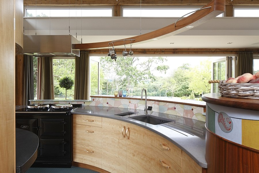 View in gallery Curved kitchen island and workstation with a lovely view of  the outdoors