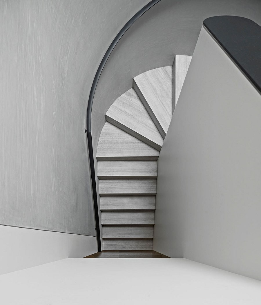 Curving staircase stands in contrast with simple, rectilinear form of the house