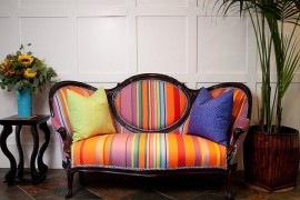 Curvy traditional couch with a colorful, modern fabric is an absolute showstopper