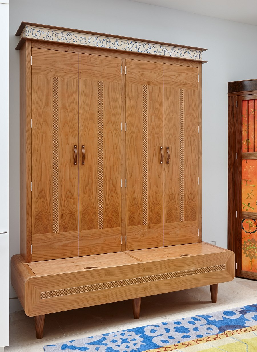 Custom-crafted cabinet offers additional seating space in the kitchen