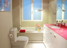 Custom-fuchsia-glass-top-adds-aura-of-hot-pink-to-the-bathroom-217x155