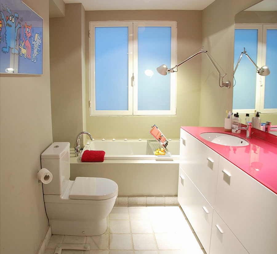 Custom fuchsia glass top adds aura of hot pink to the bathroom [Design: Isolina Mallon Interior Design]