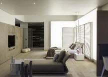 Custom illuminated wall behind the headboard defines the mood of the bedroom