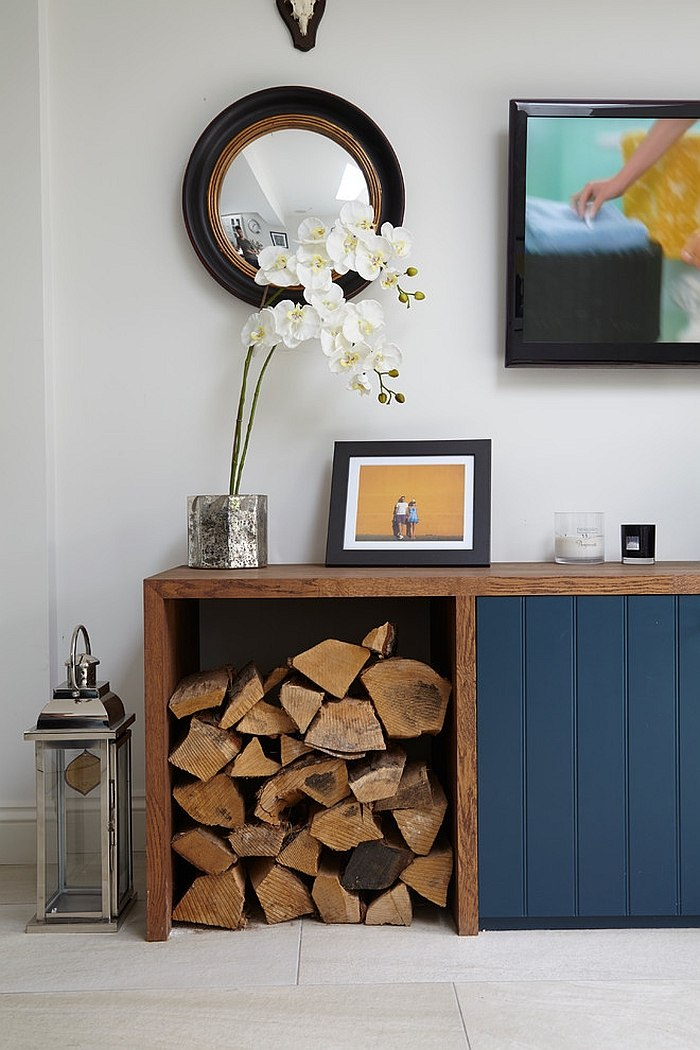 Custom living room unit with log storage [Design: Blakes London]