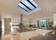 Custom skylights and pendants enliven the modern kitchen