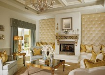 Custom upholstered panels add textural beauty to the living room
