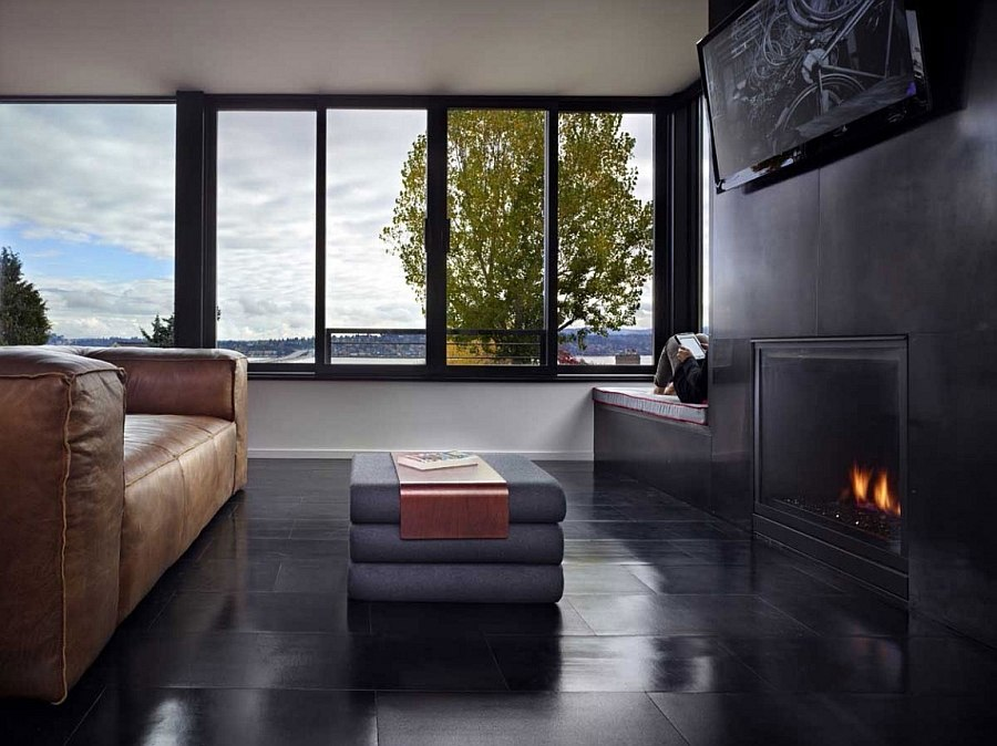 Dark living area with fireplace exudes sleek sophistication