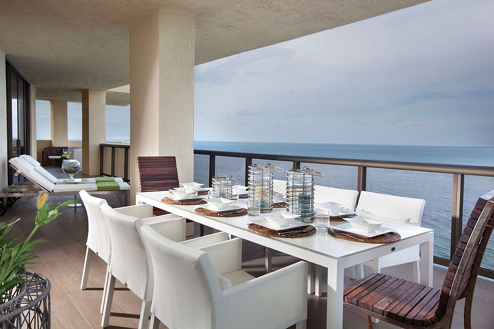 Dining area on the porch with ocean views