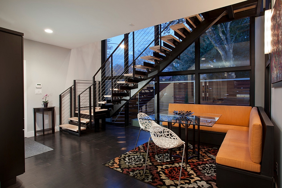 Contemporary austin renovation creates a bright colorful home for Dining room under stairs