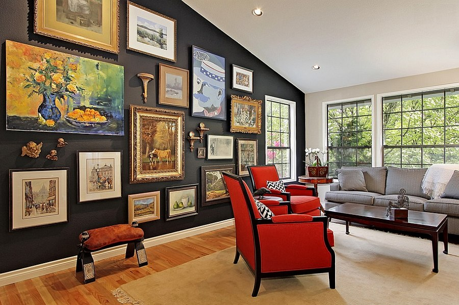 dramatic gallery wall uses the unique contours of the room to its advantage design - Galley Living Room Decorating