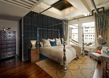 Dramatic tufted wall brings visual softness to the industrial-eclectic bedroom
