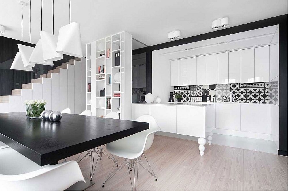 Eames chairs and creative pendants shape the dining room
