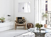 Elegant interior in white with restrained pops of black 217x155 Chic Helsinki Apartment Displays Scandinavian Design at Its Serene Best