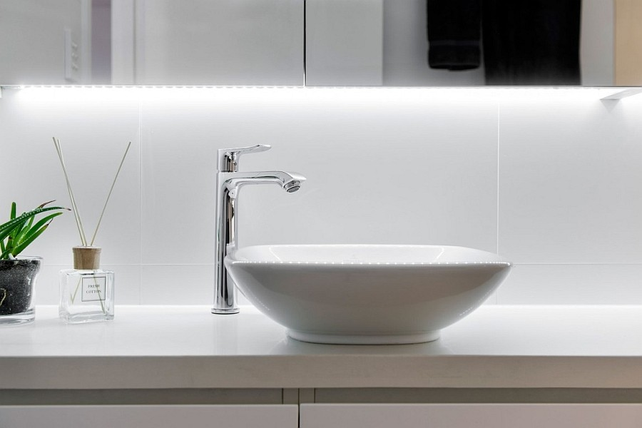 Elegant lighting adds beauty to the spa-styled bath
