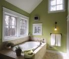 Elegant use of green inside the traditional bathroom
