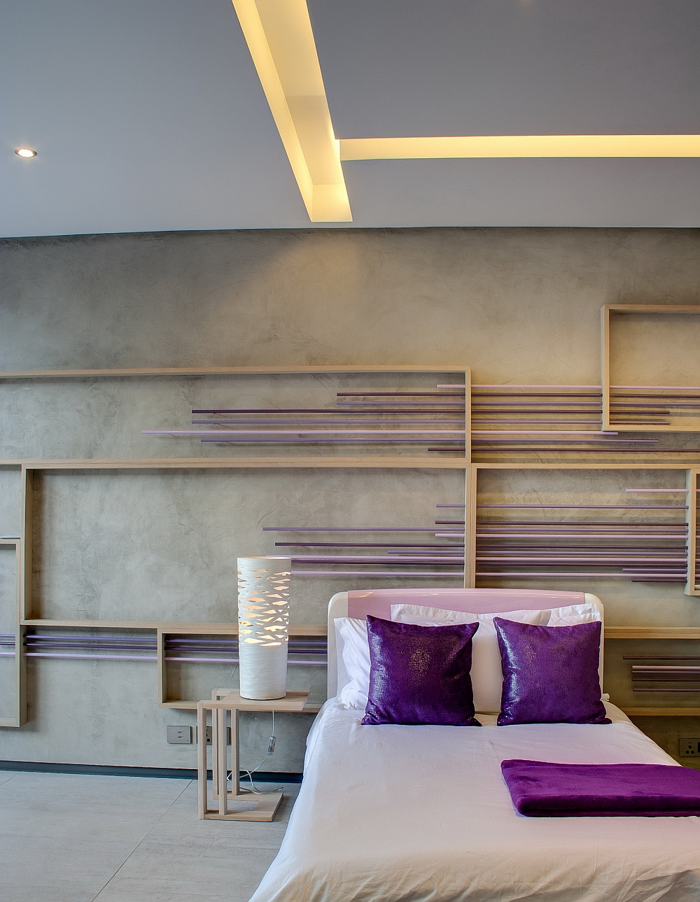 Elegant use of purple in the cozy bedroom