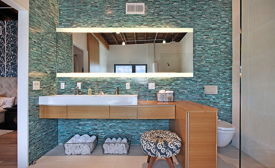 Elegant use of turquoise and black tiles in the bathroom [From: Jeri Koegel Photography]