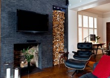 Elegantly stacked wood brings visual contrast to teh dark living space