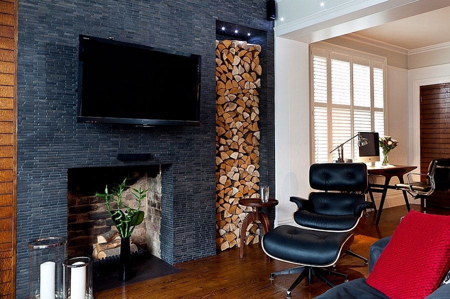Elegantly stacked wood brings visual contrast to the dark living space [Design: Boutique Homes]