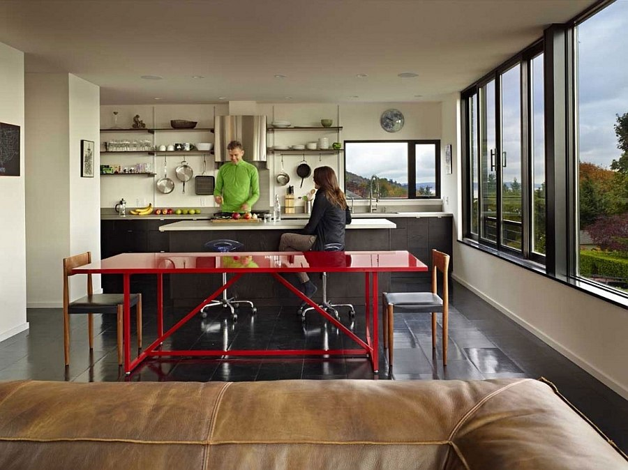 Exciting dash of red enlivens the cool kitchen space