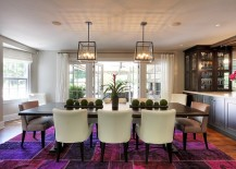 Fabulous rug in multiple shades of purple steals the show in this dining room