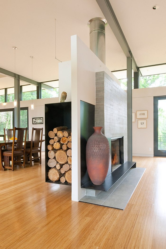 ... Fireplace And Floating Wood Storage Unit Separate The Living And Dining  Rooms [Design: McInturff