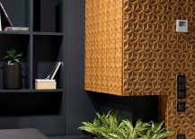 Fireplace-surrounded-by-the-3D-carved-wooden-panels-becomes-the-focal-point-of-the-room-217x155
