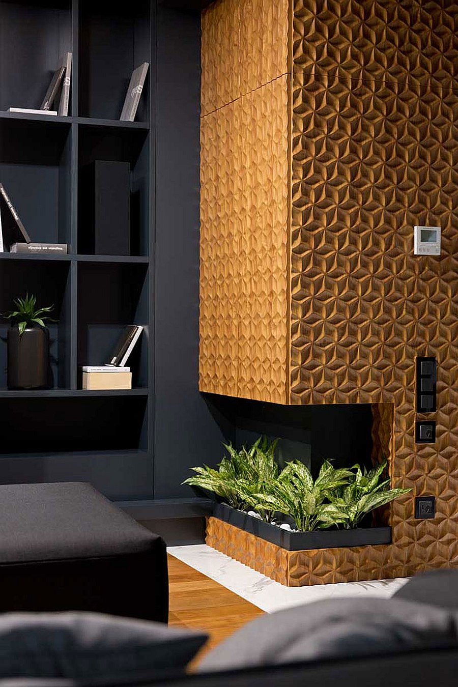 Fireplace surrounded by the 3D carved wooden panels becomes the focal point of the room