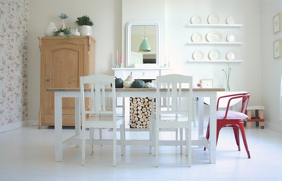 Firewood adds texture and balance to the serene dining room [From: Holly Marder]