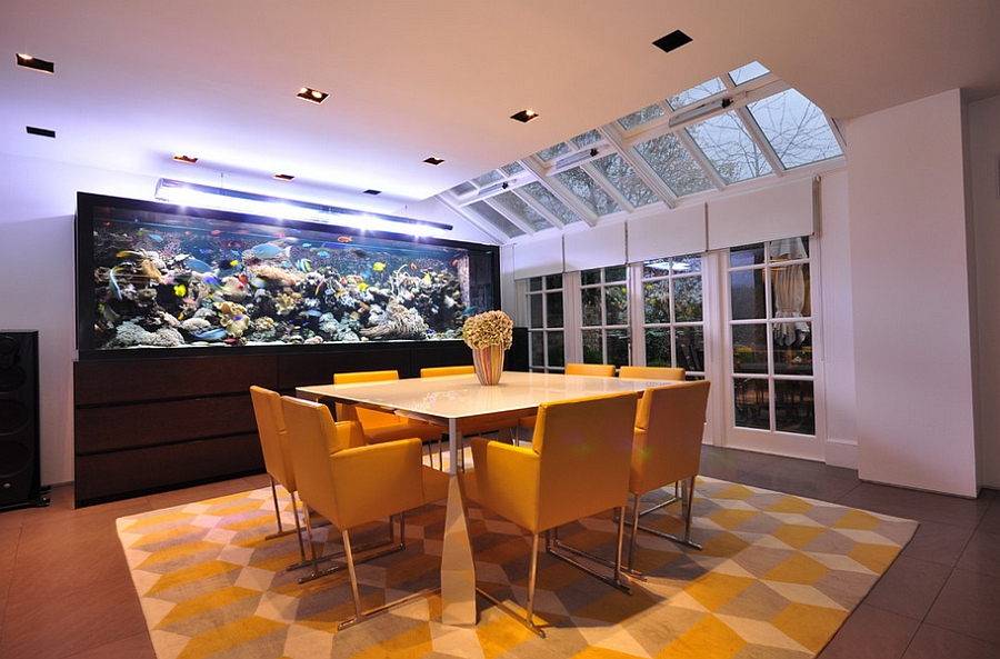 27 dining rooms with skylights that steal the show - Fish tank dining room table ...