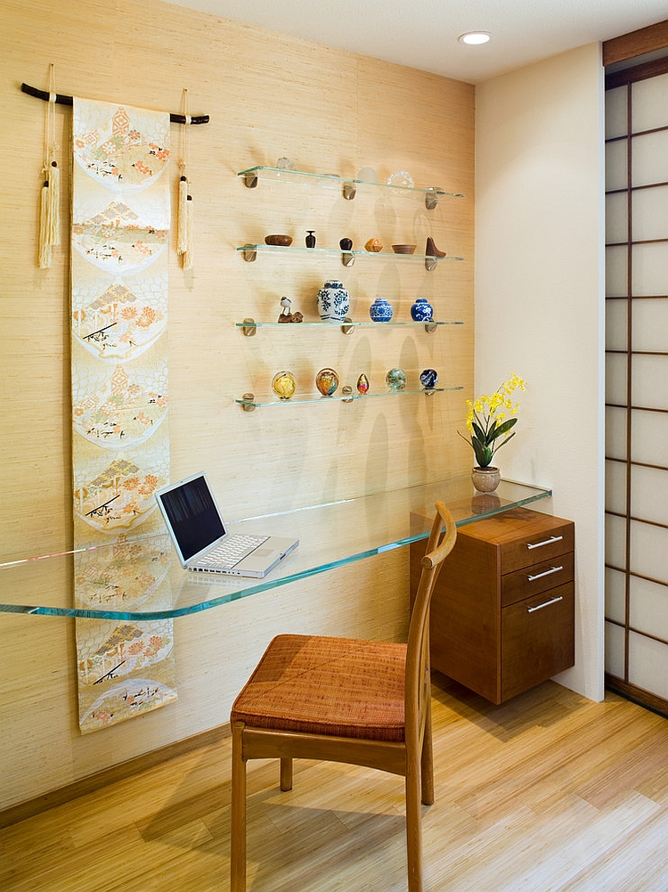 Floating glass desk and simple accessories shape this home office