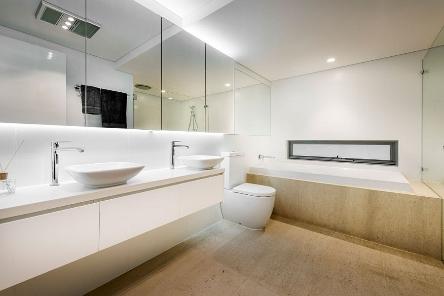 Flooring adds a touch of warmth to the minimal bath