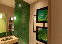 Framed stained glass additions bring artistic elegance to the green bathroom
