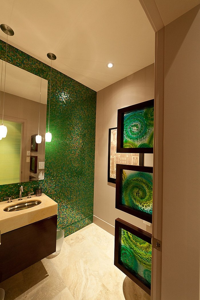 Framed stained glass additions bring artistic elegance to the green bathroom [Design: Habitat Studio]