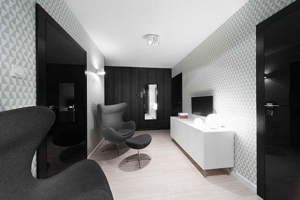 Geometric 3D wallpaper adds a layer of intrigue to the monochromatic apartment