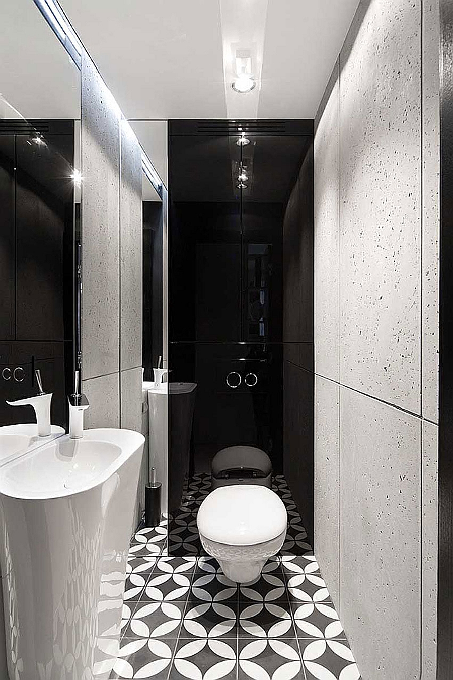 Geometric floor tiles for small black and white bathroom