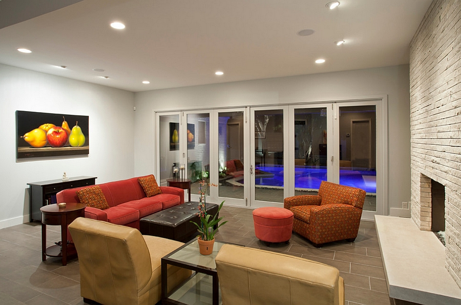 Glass doors bring naural ventilation and a sense of airiness to the room